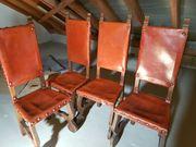4 massive Stühle