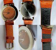 Gut gepflegte Edelstahl-Damen-Armbanduhr mit Lederarmband