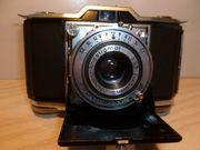 7 antike Kameras 4 mal