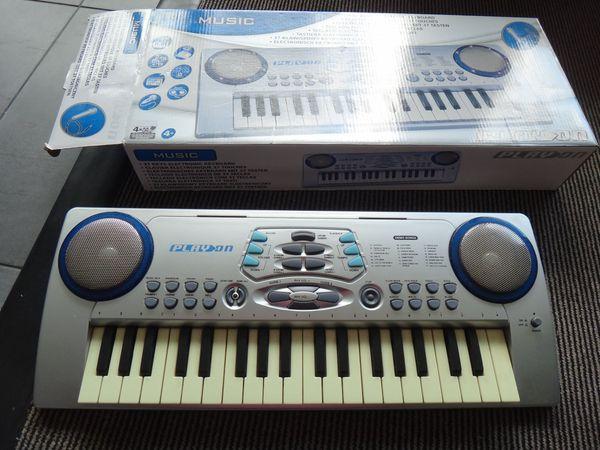 Kinder Keyboard mit Mikrofon