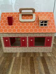 Tragbares Puppenhaus aus Holz