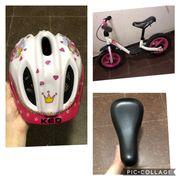 Laufrad mit Helm und Ersatzsattel