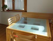 ausziehbarer Glastisch