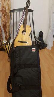 Gitarre mit Tasche und Ständer