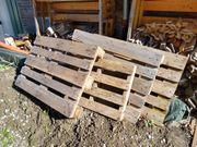 Vier Holzpaletten verschiedene Größen