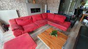 Rote Couch zu verschenken