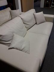 Couch 2 Sitzer cremfarbig