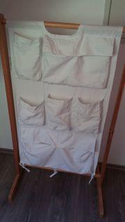 Handtuch-Ständer mit diversen Taschen