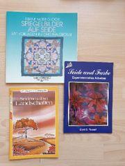 Verschiedene Seidenmalbücher mit Vorlagen in