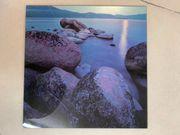 Glasbild Steine Meer