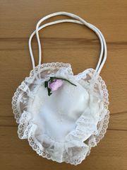Kleine weiße runde Tasche für
