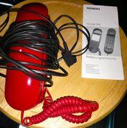 Telefon mit Bedienungsanleitung und 5
