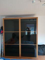 IKEA Pax mit schwarzen Schiebetüren