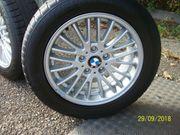 Neuwertiger Conti Winterreifenradsatz auf BMW-Alufelge
