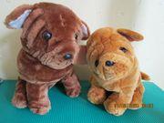 2 Stofftier-Hunde