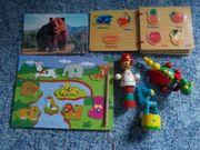 viele verschiedene Holzspielzeuge