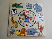 Holzpuzzle mit Tieren und Uhr