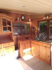 Wohnwagen als Dauerstellplatz mit Ausgebautem