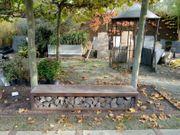 Holzlager aus Cortenstahl als Sitzbank
