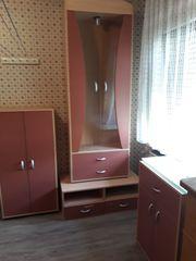 Wohnzimmermöbel Buche mit rostroten Schranktüren