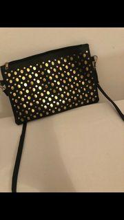 schwarz goldene Tasche