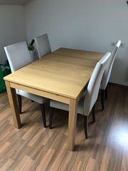 ausziehbarer Tisch mit Stühlen