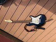 Fender E-Gitarre mit Verstärker