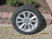 4 Winterreifen mit Original BMW-Felgen