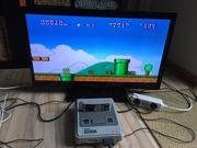 Super Nintendo mit drei Spielen