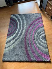 Teppich grau lila