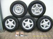 5 Ganzjahres-Reifen mit Alufelgen
