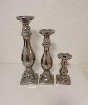 3 schöne silberne Kerzenhalter