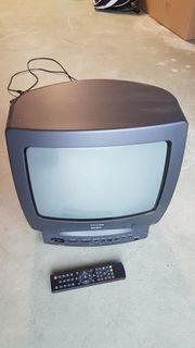 TV mit Videorecorder und Fernbedienung