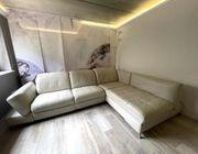 Hellgraue Echtleder-Couch inkl per touch
