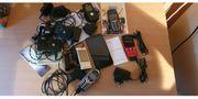 Acht gebrauchte Mobiltelefone Handys