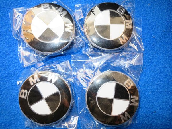 4 original BMW Neu Nabenkappen