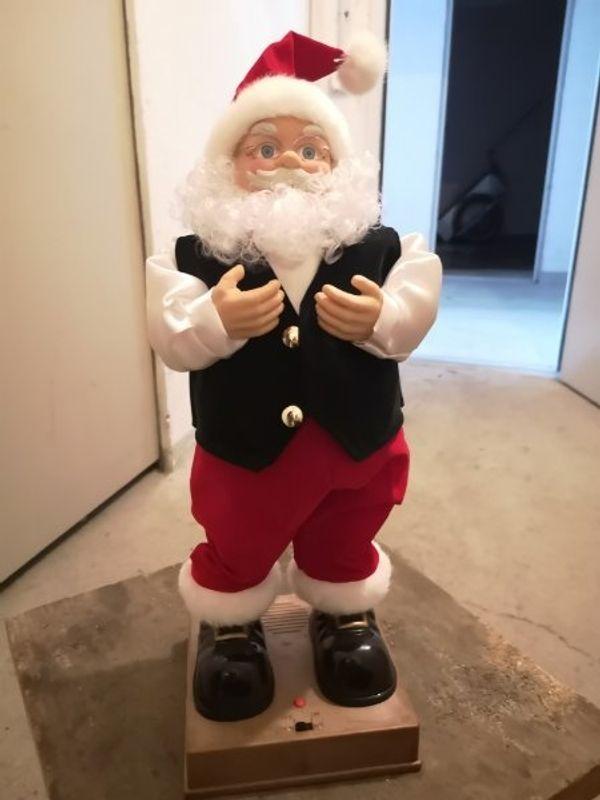 Weihnachtmann singend