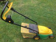 kleiner funktionstüchtiger elektrischer Rasenmäher abzugeben