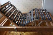 Holzbettgestell mit stufenlos elektrisch verstellbarem