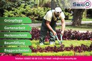 Gartenarbeit Rasen mähen Hecke schneiden