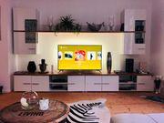 Wohnwand Wohnzimmer Hochglanz weiß Holz