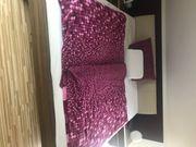 Doppelbett mit passenden Nachttische