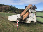 Abrollcontainer mit Palfinger Kranaufbau