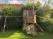 Modifiziertes WINNETOO Spielhaus mit Schaukel