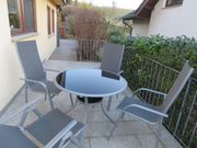 Glas-Terrassentisch mit Stühle
