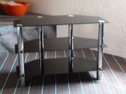 Schwarzer Glastisch mit Chrom Füßen