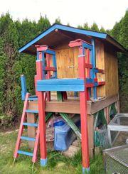 Kinderspielhütte mit 2 x Rutschbahn