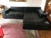 Schwarze Couch Kunstleder gross und