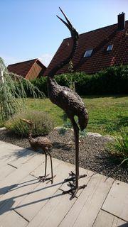Bronzefiguren Kranich groß und klein