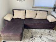 L-Couch mit Bettkasten und Schlaffunktion